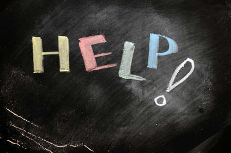 Help written with chalk on a blackboard Stock Photo - 11690894