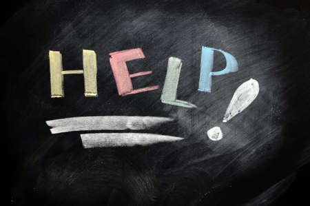 Help written with chalk on a blackboard Stock Photo - 11690892