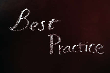 Text of Best Practice written with chalk on a blackboard photo
