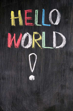 Hello, World! - message from the first computer program written on blackboard photo