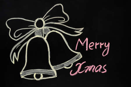 Jingle bells drawn with chalk on a blackboard photo