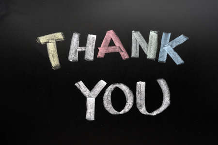 Thank you - text written with chalk on a blackboard