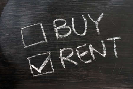 Buy or sell check boxes on a blackboard. Finance, economy, stock or real estate concept - time to buy or sell. photo