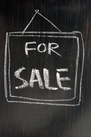 For sale - text written with chalk on a blackboard. photo