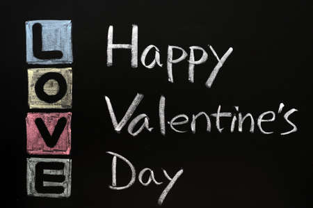 Love with Happy Valentines Day on a chalkboard  photo