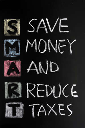 reduce taxes: Smart goal concept on blackboard for setting management objectives