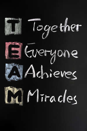 TEAM acronym written in colorful chalk on blackboard Stock Photo - 11714607