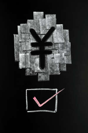 Symbol of Chinese Yuan drawn with chalk on blackboard,with a check box photo