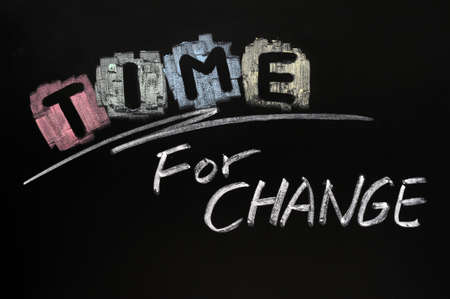 change concept: Time for change written with chalk on blackboard Stock Photo