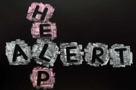 Crossword of Help Alert written in chalk on a blackboard Stock Photo - 11803877