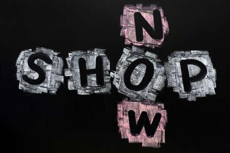 Crossword of Shop Now written in chalk on a blackboard Stock Photo - 11803887