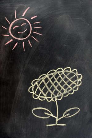Sunflower under the sun drawn with chalk on a blackboard photo