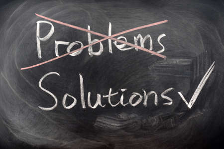 Crossing out problems with solutions chosen on a blackboard photo