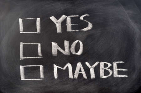 Yes, no and maybe check boxes written on blackboard photo