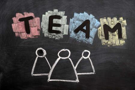 Teamwork concept written with chalk on blackboard