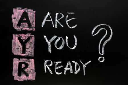 ready: Are you ready question written in chalk on a blackboard