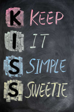 love words: KISS acronym written in colorful chalk on a blackboard