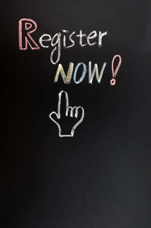 Register now button with a hand shape drawn on blackboard photo