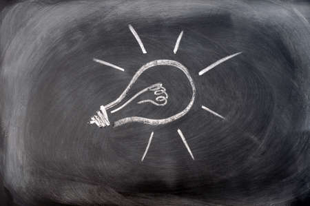 Light bulb drawn on a blackboard, concept for ideas and innovation photo
