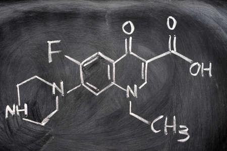 Chemical structures written with chalk on a blackboard photo