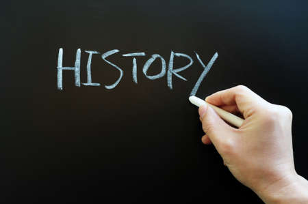 Writing the word history with chalk on a blackboard Stock Photo - 11939402
