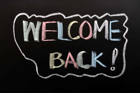 Welcome back written in colorful chalk on a blackboard photo