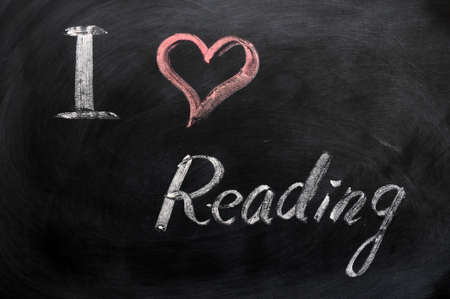 I love reading - text written with chalk on a blackboard photo