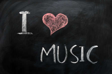I love music - text written with chalk on a blackboard photo