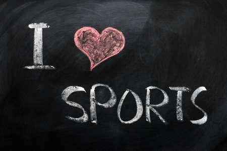 I love sports - text written with chalk on a blackboard photo
