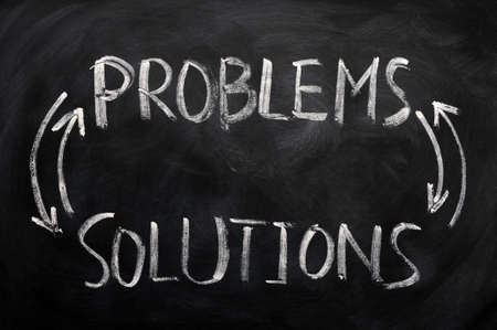 problems solutions: Problems and solutions written with chalk on a blackboard