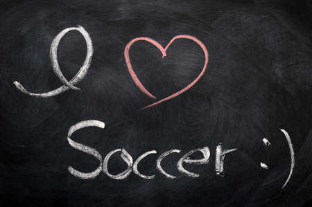 I love soccer - text written with chalk on a blackboard photo