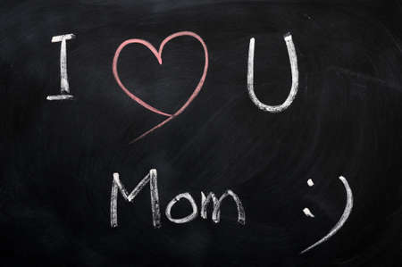 I love you Mom - text written with chalk on a blackboard photo