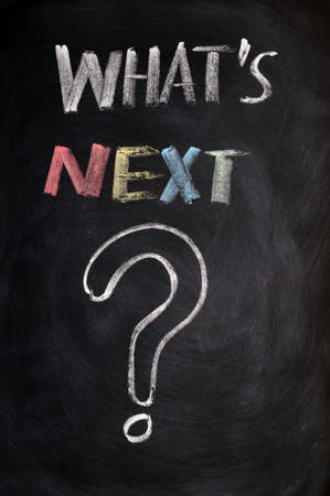 What's next with a big question mark drawn with chalk on a blackboard Stock Photo - 11939556