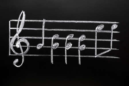 musical score: Clef drawn in chalk on a blackboard Stock Photo