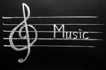 composers: Clef drawn in chalk on a blackboard Stock Photo