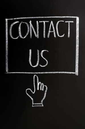 Contact us button with a cursor hand drawn on a blackboard photo