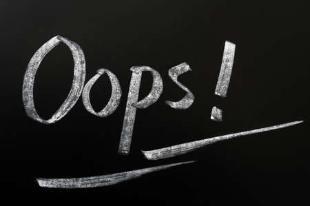 Oops with an exclamation mark written in chalk on a blackboard Stock Photo