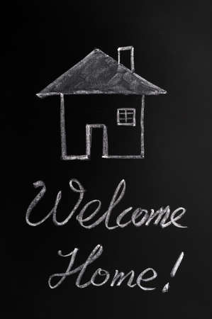 Welcome home written with chalk on a blackboard Stock Photo - 11939420