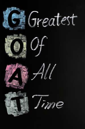 greatest: Goat acronym - Greatest of all time written on a blackboard