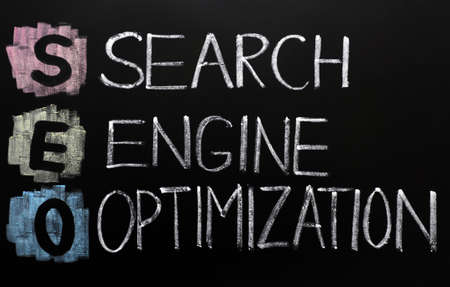 optimize: SEO acronym - Search engine optimization written on a blackboard