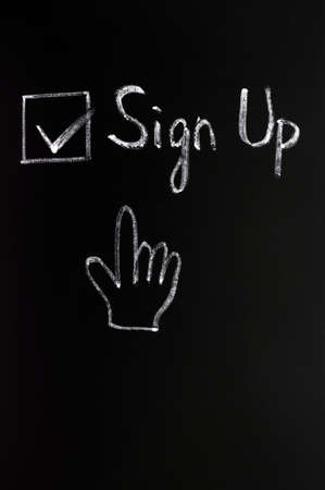 Sign up check box with a cursor hand on a blackboard photo