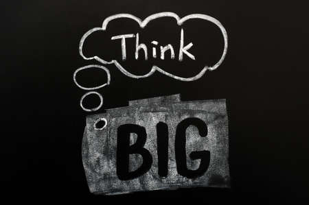 Think big handwritten in chalk on a blackboard photo