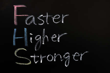 olympic: Olympic motto (faster, higher, stronger) handwritten with chalk on blackboard