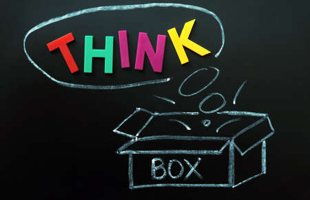 Think outside the box concept made of colorful letters and chalk drawing Stock Photo - 11939474