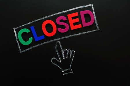 Closed button with a cursor hand drawn in chalk on a blackboard  photo