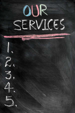 our: Our services menu with copy space written in chalk on a blackboard