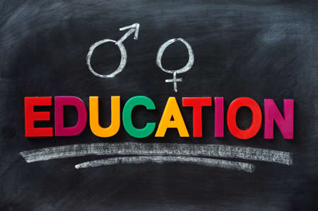 sex education: Sex education concept on a smudged blackboard Stock Photo