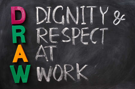dignity: DRAW acronym written on a smudged blackboard