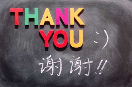 old english letters: Thank you with a Chinese version written on a blackboard