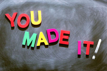 You made it - text made of colorful letters on a smudged blackboard photo